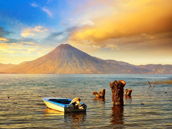 Beatiful sunset at the lake Atitlan near the volcano. Guatemala